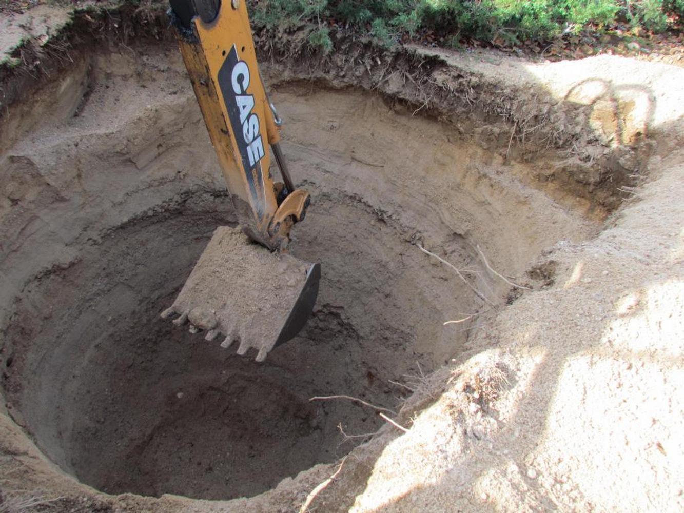 раскопка дренажной ямы